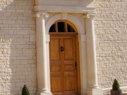 A Hand carved door surround in Natural English Limestone