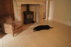 Bespoke English limestone fireplace surrounding cast Iron wood burning stove.