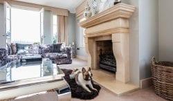David lancaster interior limestone fireplace