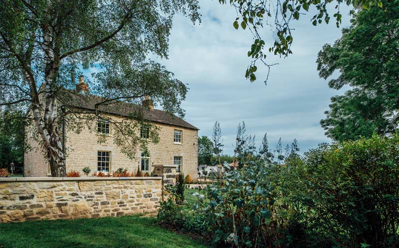 Lodge Farm Grey cropped walling Holden opus paving garden