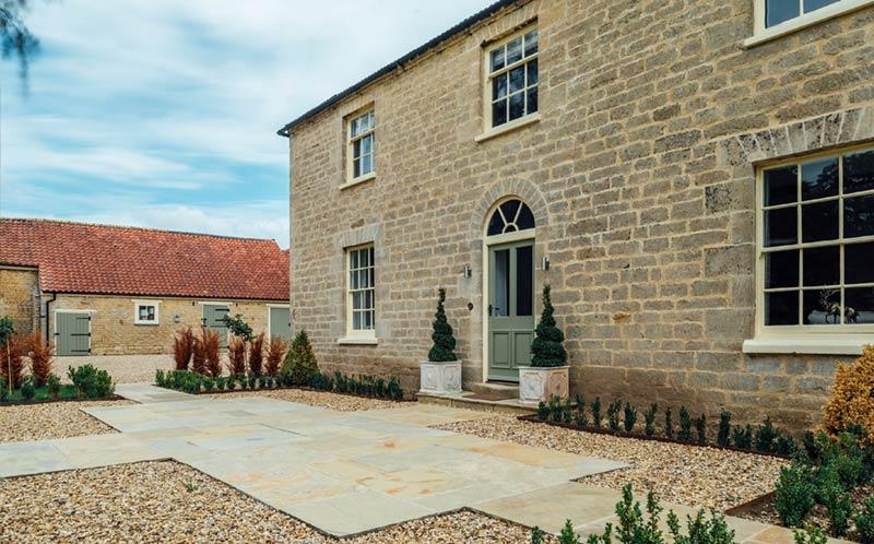 Lodge Farm Grey cropped walling Holden opus paving rear